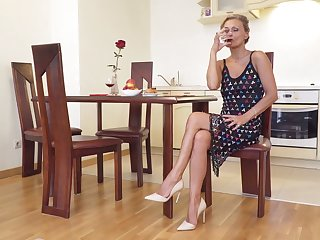 Sexually charged mature woman Bonita is playing with her smooth pussy