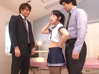 Japanese brunette teen Kanae Ruka takes two cocks in uniform