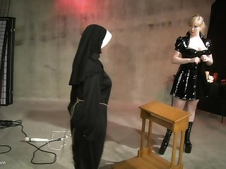 Leathered up blonde uses a whip to make her slave's ass turn red