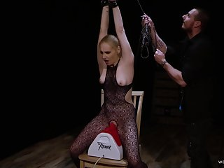 Blonde in fisnets tied up and forced to ride sex machine until orgasm