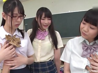 Japanese teens in miniskirts play with and ride one lucky dick