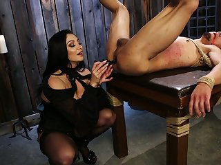 Cruel mistress Lea Lexis puts on strapon and fucks anus of submissive dude
