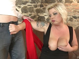 Tattooed mature deals young son's huge dick like a pro