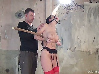 Slender brunette with yummy boobies Cindy Dollar is tied up and punished in the basement