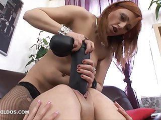 Brunette lesbian moans while getting spooked with a massive dildo
