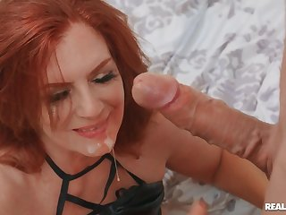 Redhead mature takes off her panties to be fucked on the bed