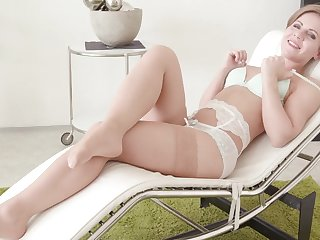 Video of sexy mature Sasha Zima pleasuring her cravings on a sofa