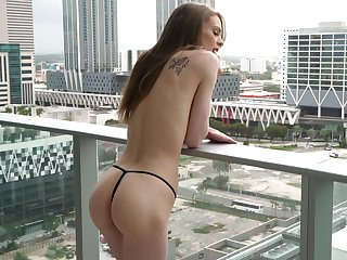 Sexy city-dweller Jessae Rosae makes love in front of an open window