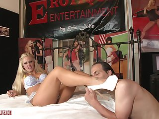 Blonde porn doll strips naked to shag with an older man